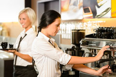 Staff at cafe making coffee espresso machine Royalty Free Stock Images
