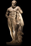 A statue of powerful Hercules, closeup, isolated in black Stock Photos