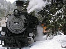 Steam locomotive in snow Royalty Free Stock Photos