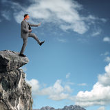 Stepping off a cliff ledge Royalty Free Stock Photography