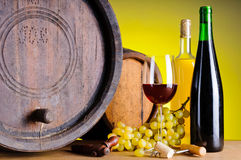Still life with wine, grapes and barrels Royalty Free Stock Images