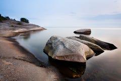 Stones in calm sea Royalty Free Stock Photos