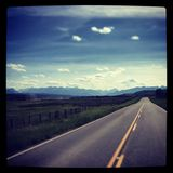 Straight rood to the rocky mountains Royalty Free Stock Image