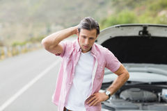 Stressed man waiting assistance after a car breakdown Royalty Free Stock Photos