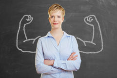 Strong business woman with muscles Royalty Free Stock Images