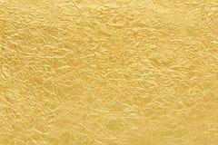 Struttura del fondo della stagnola di oro Fotografia Stock