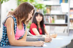 Student cheating at test exam Royalty Free Stock Photos