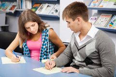 Student cheating at test exam Stock Photo