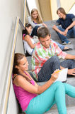 Students talking relaxing on school steps teens Stock Photography