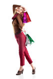 Studio shot of beautiful girl is in fashion style  with shopping Stock Photography