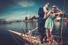 Stylish couple on a luxury yacht Royalty Free Stock Photography