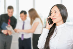 Successful asian business woman using mobile phone Royalty Free Stock Photography