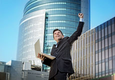 Successful businessman with computer laptop happy doing victory sign Royalty Free Stock Photos
