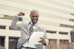 Successful man celebrates success holding new contract documents Stock Images