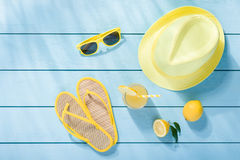 Summer accessories on blue wooden background Stock Image