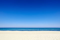Summer blue sky sea coast sand background beach Royalty Free Stock Image