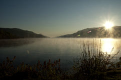 Sunrise on a misty lake - New Day - Peaceful and P Stock Photos