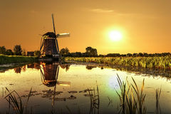 Sunrise on a Windmill Stock Images