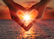 Sunset in heart hands Royalty Free Stock Photography