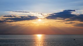 Sunset sky over ocean Stock Photo
