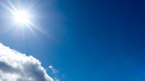 Sunshine against blue sky Royalty Free Stock Images