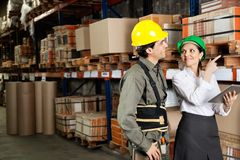 Supervisor With Foreman Pointing At Stock On Stock Photo