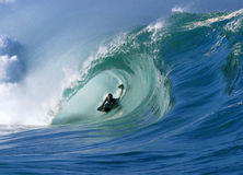 Surfing a Perfect Tube Wave at Waimea Bay Hawaii Royalty Free Stock Photography