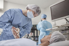 Surgeon consulting a patient, holding hands, getting ready for surgery Royalty Free Stock Photo