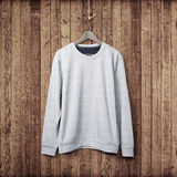 Sweater on a wood wall Royalty Free Stock Photos