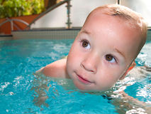 Swimming baby Stock Images