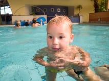 Swimming baby Stock Photos