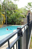 Swimming pool fence Stock Photography