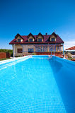 Swimming pool in the yard Royalty Free Stock Photos