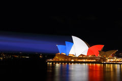 Sydney Opera House lit in colours of French Flag red white blue Stock Photos