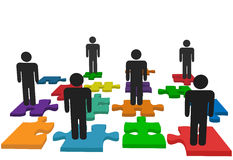 Symbol people team stand on jigsaw puzzle pieces Royalty Free Stock Photography