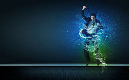 Talented cheerful businessman jumping with glowing energy lines Royalty Free Stock Photography