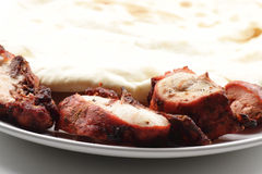 Tandoori Chicken and Cheese Naan Bread Royalty Free Stock Images