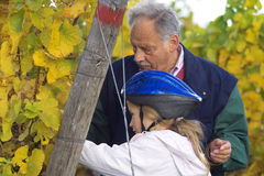 Tasting the grapes with grandfather Stock Photography