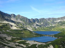 Tatra mountains in Poland, green hill, valley and rocky peak in the sunny day with clear blue sky Royalty Free Stock Photo