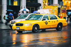 Taxi cab in New York City in the rain Stock Images