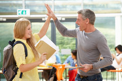 Teacher Congratulating Pupil On Successful Exam Result Royalty Free Stock Image