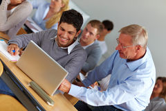 Teacher giving assistance in class Royalty Free Stock Photography