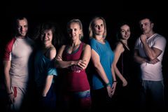 Teamwork concept.Fitness workout team motivation.Group of athletic healthy adults in gym .United fitness and aerobic trainers. Stock Image