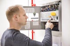 Technician checks fire panel in data center Royalty Free Stock Photo