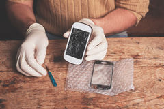 Technician fixing smart phone Royalty Free Stock Image
