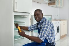 Technician Repairing Refrigerator Appliance Stock Photography