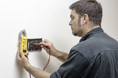 Technician working on a thermostat Royalty Free Stock Images