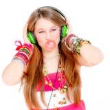 Teen blowing gum listening music Royalty Free Stock Image