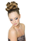 Teen girl with fashion hairstyle and make-up Stock Photography