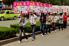 Teenage Chinese Girls with Advertising Placards, Kaifeng, China  Stock Photos